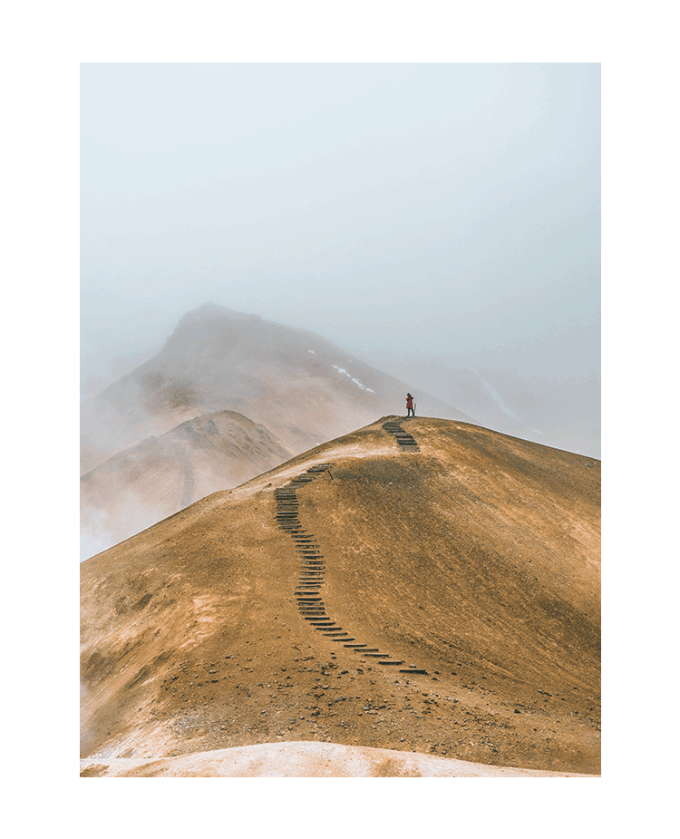 Image of a Man Walking Alone in the Fog