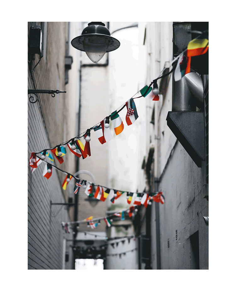 World Flags Hanging in an Alleyway